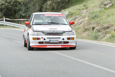 velazquez: LA CABRERA, SPAIN - APRIL 25th 2015: Madrid rally championship. Ruben Velazquez is driving his -Ford Escort RS Cosworth-, during the ascent to -La Cabrera-, on April 25th 2015. He finished 5th.