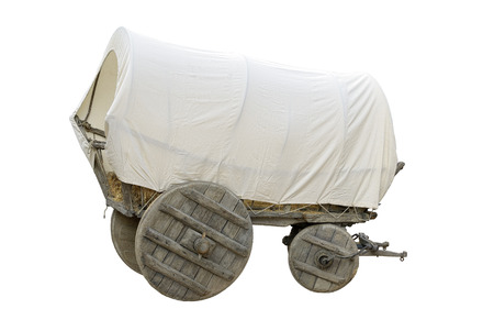 Vintage covered wagon used to transport straw, people and others things in western time