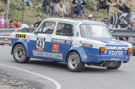 ascent: LA CABRERA, SPAIN - APRIL 25th 2015: Madrid rally championship. Unknown people watching to Jose R. Rodriguez in his -Simca 1000-, during the ascent to -La Cabrera-, on April 25th 2015. He finished 14th. Editorial