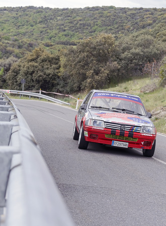 pull out: LA CABRERA, SPAIN - APRIL 25th 2015: Madrid rally championship. Alcides Pinho is driving his -Peugeot 205 Rallye-, during the ascent to -La Cabrera-, on April 25th 2015. He had to pull out of the race.