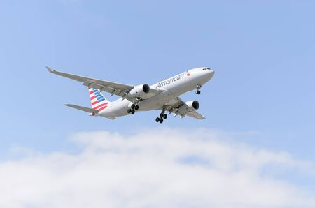 american airlines: MADRID SPAIN  MAY 23th 2015: Aircraft Airbus A330 of American Airlines airline landing on Madrid Barajas Adolfo Suarez airport on May 23th 2015.