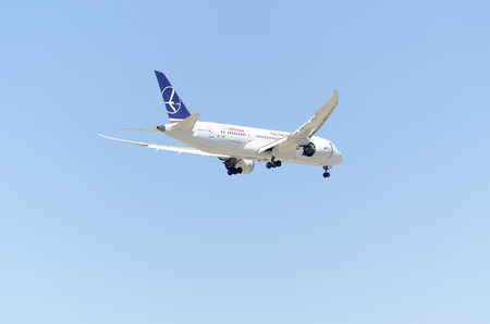 rented: MADRID, SPAIN - MAY 23th 2015: Aircraft -Boeing 787-8 Dreamliner-, of -Air Europa- airline, landing on Madrid-Barajas -Adolfo Suarez- airport, on May 23th 2015. It has been rented to -LOT Polish Airlines-.