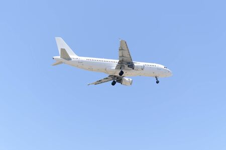 jumbo jet: MADRID, SPAIN - MAY 23th 2015: Aircraft -Airbus A320-211-, of -SmartLynx- airline, landing on Madrid-Barajas -Adolfo Suarez- airport, on May 23th 2015. Editorial
