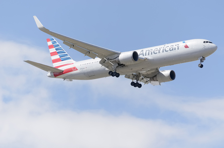 american airlines: MADRID, SPAIN - MAY 23th 2015: Aircraft -Boeing 767-323-, of -American Airlines- airline, landing on Madrid-Barajas -Adolfo Suarez- airport, on May 23th 2015. Editorial