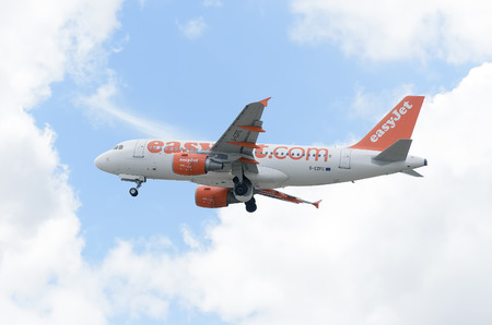 taking off: MADRID, SPAIN - JUNE 14th 2015: Aircraft -Airbus A319-111-, of -EasyJet- airline, is taking off from Madrid-Barajas -Adolfo Suarez- airport, on June 14th 2015.