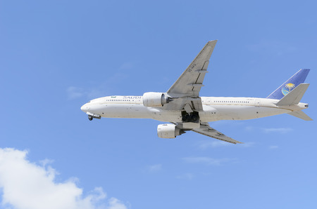 taking off: MADRID, SPAIN - JUNE 14th 2015: Aircraft -Boeing 777-268-, of -Saudi Arabian Airlines- airline, is taking off from Madrid-Barajas -Adolfo Suarez- airport, on June 14th 2015.