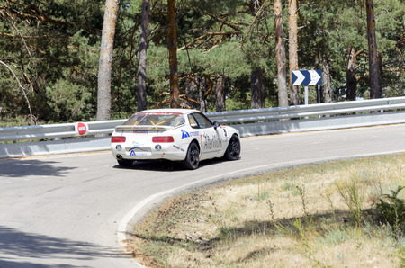 ascent: CANENCIA, SPAIN - JULY 25th 2015: Madrid rally championship. -Porsche 968 CS-, of Fernando Navarrete, during the ascent to the mountain pass of Canencia, on July 25th 2015. Fernando Navarrete finished in 6th position.