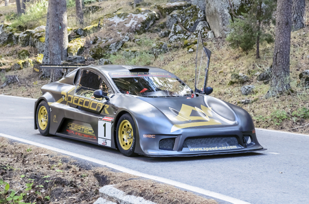 ascent: CANENCIA, SPAIN - JULY 25th 2015: Madrid rally championship. Winner car, -Speed Car GTR EVO-, of Juan Castillo Fernandez, during the ascent to the mountain pass of Canencia, on July 25th 2015. Juan Castillo won the race.