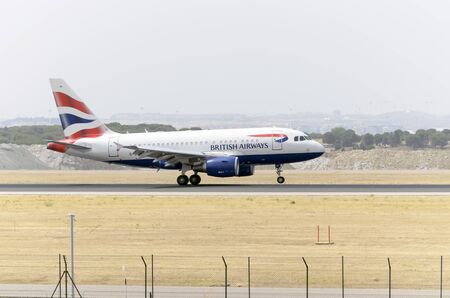 jumbo jet: MADRID, SPAIN - AUGUST 8th 2015: Aircraft -Airbus A318-112-, of -British Airways- airline, is landing on Madrid-Barajas -Adolfo Suarez- airport, on August 8th 2015. Editorial