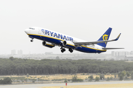 taking off: MADRID, SPAIN - AUGUST 8th 2015: Aircraft -Boeing 737-8AS-, of -Ryanair- airline, is taking off from Madrid-Barajas -Adolfo Suarez- airport, on August 8th 2015.