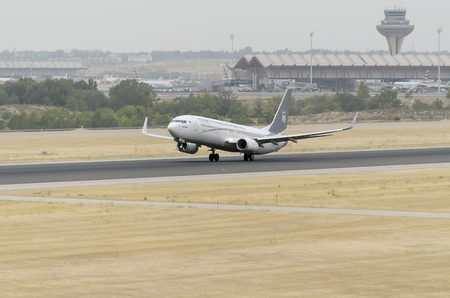 intercontinental: MADRID, SPAIN - AUGUST 8th 2015: Aircraft -Boeing 737-8FB-, of -Ceiba Intercontinental- airline, is taking off from Madrid-Barajas -Adolfo Suarez- airport, on August 8th 2015.
