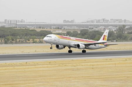 taking off: MADRID, SPAIN - AUGUST 8th 2015: Aircraft -Airbus A321-211-, of -Iberia- airline, is taking off from Madrid-Barajas -Adolfo Suarez- airport, on August 8th 2015. Editorial