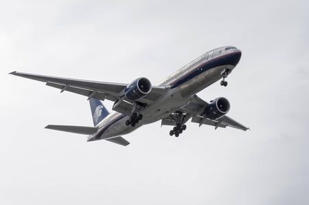 february 14th: MADRID, SPAIN - FEBRUARY 14th 2015: Aircraft -Boeing 777-200ER-, of -Aeromexico- airline, is landing on Madrid-Barajas -Adolfo Suarez- airport, on February 14th 2015.