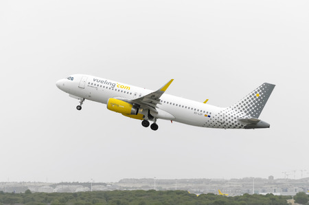 jumbo jet: MADRID, SPAIN - AUGUST 8th 2015: Aircraft -Airbus A320-232-, of -Vueling- airline, is taking off from Madrid-Barajas -Adolfo Suarez- airport, on August 8th 2015.