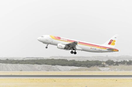 jumbo jet: MADRID, SPAIN - AUGUST 8th 2015: Aircraft -Airbus A320-214-, of -Iberia- airline, is taking off from Madrid-Barajas -Adolfo Suarez- airport, on August 8th 2015. Editorial