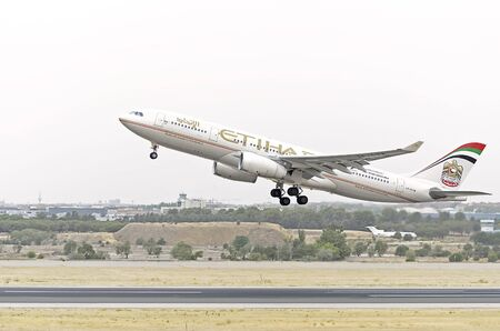 jumbo jet: MADRID, SPAIN - AUGUST 8th 2015: Aircraft -Airbus A330-243-, of -Etihad Airways- airline, is taking off from Madrid-Barajas -Adolfo Suarez- airport, on August 8th 2015.