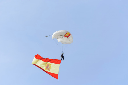 fairs: ALCALA DE HENARES, SPAIN - AUGUST 29th 2014: Unidentified parachutist of spanish police is landing in Alcala de Henares, during a show, on August 29th 2014. Army and security corps of Spain have done a show, during the fairs of Alcala de Henares.
