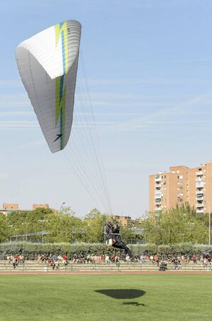 fairs: ALCALA DE HENARES, SPAIN - AUGUST 29th 2015: Unidentified soldier of -C.VENTURY- group, is doing a show, landing in Alcala de Henares, on August 29th 2015. Army and security corps of Spain have done a show, during the fairs of Alcala de Henares. Editorial