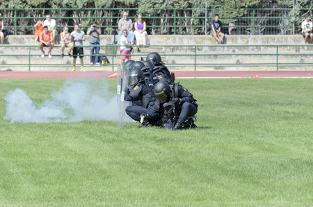 fairs: ALCALA DE HENARES, SPAIN - AUGUST 29th 2014: Unidentified group of spanish policemen is doing a show in Alcala de Henares, on August 29th 2014. Army and security corps of Spain have done a show, during the fairs of Alcala de Henares.