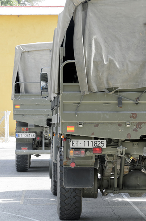 fairs: ALCALA DE HENARES, SPAIN - AUGUST 29th 2014: Rear view of two trucks -Iveco- of spanish army, during a show, in Alcala de Henares, on August 29th 2014. Army and security corps of Spain have done a show, during the fairs of Alcala de Henares.