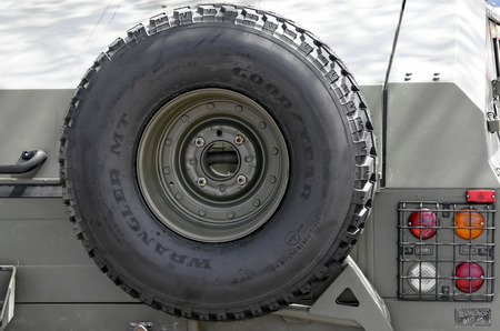 fairs: ALCALA DE HENARES, SPAIN - AUGUST 29th 2015: Spare tire of URO VAMTAC, -High Mobility Tactical Vehicle- of spanish army, during a show, in Alcala de Henares, on August 29th 2015. Army and security corps of Spain have done a show, during the fairs of Alcal