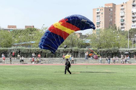 fairs: ALCALA DE HENARES, SPAIN - AUGUST 29th 2015: Unidentified parachutist of armed forces, is doing a show, landing in Alcala de Henares, on August 29th 2015. Army and security corps of Spain have done a show, during the fairs of Alcala de Henares.
