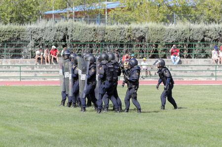 fairs: ALCALA DE HENARES, SPAIN - AUGUST 29th 2015: Unidentified group of spanish policemen are doing a show in Alcala de Henares, on August 29th 2015. Army and security corps of Spain have done a show, during the fairs of Alcala de Henares. Editorial