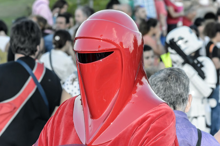 royal guard: TORREJON DE ARDOZ, SPAIN - SEPTEMBER 12th 2015: VII Training day of spanish garrison 501st legion, -Star wars-. Charitable parade in favor of -the red cross-. Unidentified man disguised of -Royal Guard soldier-, by the streets of Torrejon de Ardoz, on Sep