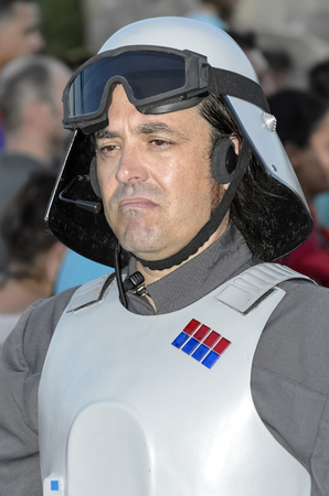 legion: TORREJON DE ARDOZ, SPAIN - SEPTEMBER 12th 2015: VII Training day of spanish garrison 501st legion, -Star wars-. Charitable parade in favor of -the red cross-. Unidentified man disguised of -Imperial officer-, by the streets of Torrejon de Ardoz, on Septem