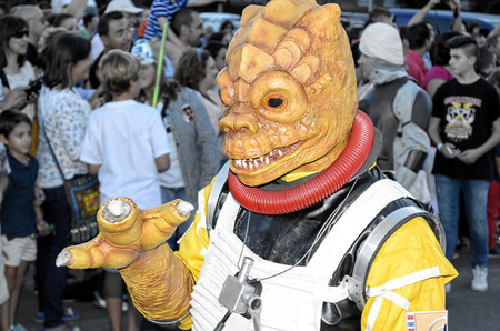 garrison: TORREJON DE ARDOZ, SPAIN - SEPTEMBER 12th 2015: VII Training day of spanish garrison 501st legion, -Star wars-. Charitable parade in favor of -the red cross-. Unidentified man disguised of -Bossk-, by the streets of Torrejon de Ardoz, on September 12th 20