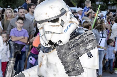 legion: TORREJON DE ARDOZ, SPAIN - SEPTEMBER 12th 2015: VII Training day of spanish garrison 501st legion, -Star wars-. Charitable parade in favor of -the red cross-. Unidentified man disguised of -Sandtrooper-, by the streets of Torrejon de Ardoz, on September 1