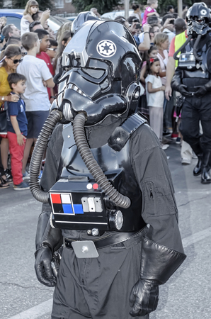 fighter pilot: TORREJON DE ARDOZ, SPAIN - SEPTEMBER 12th 2015: VII Training day of spanish garrison 501st legion, -Star wars-. Charitable parade in favor of -the red cross-. Unidentified man disguised of -TIE fighter pilot-, by the streets of Torrejon de Ardoz, on Septe