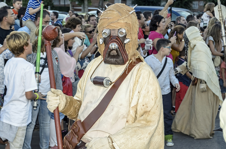 garrison: TORREJON DE ARDOZ, SPAIN - SEPTEMBER 12th 2015: VII Training day of spanish garrison 501st legion, -Star wars-. Charitable parade in favor of -the red cross-. Unidentified man disguised of -Tusken Raider-, by the streets of Torrejon de Ardoz, on September