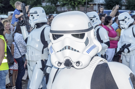 stormtrooper: TORREJON DE ARDOZ, SPAIN - SEPTEMBER 12th 2015: VII Training day of spanish garrison 501st legion, -Star wars-. Charitable parade in favor of -the red cross-. Unidentified man disguised of -Stormtrooper ANH Stunt-, by the streets of Torrejon de Ardoz, on