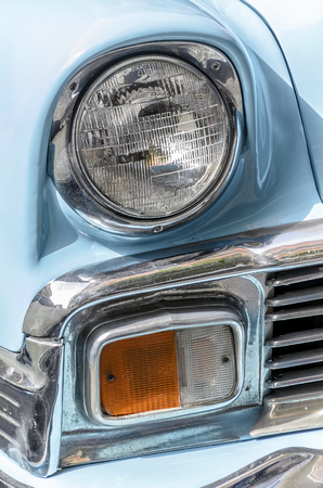 bel air: TORREJON DE ARDOZ, SPAIN - OCTOBER 3th 2015: Meeting of classic american cars, during the patronal festivals, by the streets of Torrejon de Ardoz, on October 3th 2015. Front headlights of, beautiful blue car, Chevrolet Bel Air, of 1956.