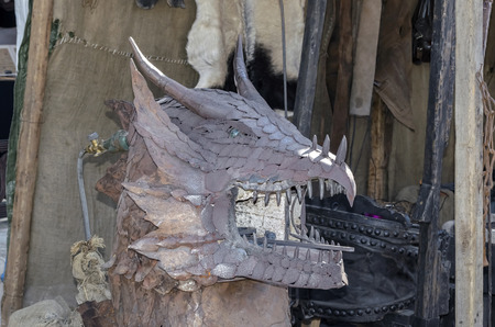 medieval blacksmith: ALCALA DE HENARES, SPAIN - OCTOBER 9th 2015: Iron sculpture of a dragon, during Cervantess week, in Alcala de Henares, on October 9th 2015. The largest mediavel market of Spain and Europe is organized during these days, around the historic center of Alca