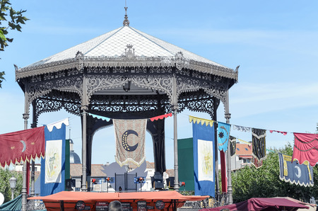 bandstand: ALCALA DE HENARES, SPAIN - OCTOBER 9th 2015: Bandstand, of Cervantes square, with medieval emblems, during Cervantess week, in Alcala de Henares, on October 9th 2015. The largest mediavel market of Spain and Europe is organized during these days, around