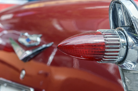 bel air: TORREJON DE ARDOZ, SPAIN - OCTOBER 3th 2015: Meeting of classic american cars, during the patronal festivals, by the streets of Torrejon de Ardoz, on October 3th 2015. Rear headlight of Chevrolet Bel Air, of 1957.