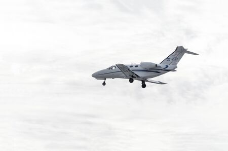 charter: MADRID, SPAIN - OCTOBER 24th 2015: Aircraft -Cessna 510 Citation Mustang-, of -Globe Air- charter airline, is landing on Madrid-Barajas -Adolfo Suarez- airport, on October 24th 2015. Moment when is getting dark at the end of afternoon.