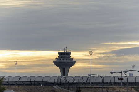 torre di controllo: MADRID, SPAIN - OCTOBER 24th 2015: View of control tower, in Madrid-Barajas -Adolfo Suarez- airport, when the day is getting dark at the end of afternoon, on October 24th 2015. Editoriali
