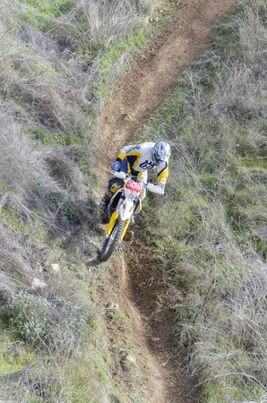 scrambler: GUADALAJARA, SPAIN - FEBRUARY 21th 2016: Spain cross country championship. Aerial view of motorcyclist with Husqvarna motorcycle, during first race of season 2016, in Guadalajara, on February 21th 2016.