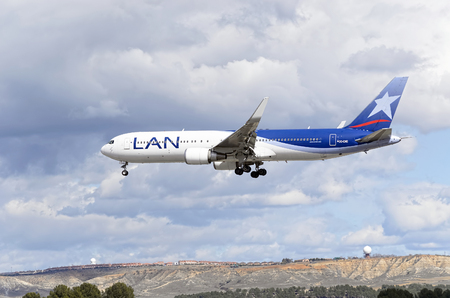 twin engine: MADRID, SPAIN - MARCH 05th 2016: Aircraft -Boeing 767-316(ER)-, of -LAN Airlines- airline, is coming, ready to land, to Madrid Barajas airport (Spain), on March 05th 2016.