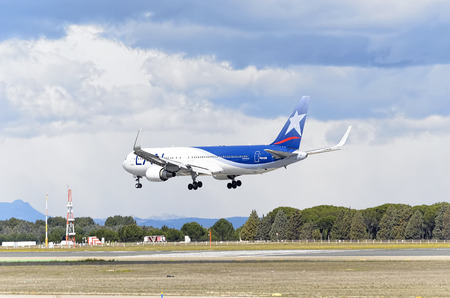 twin engine: MADRID, SPAIN - MARCH 05th 2016: Aircraft -Boeing 767-316(ER)-, of -LAN Airlines- airline, is landing in Madrid Barajas airport (Spain), on March 05th 2016.