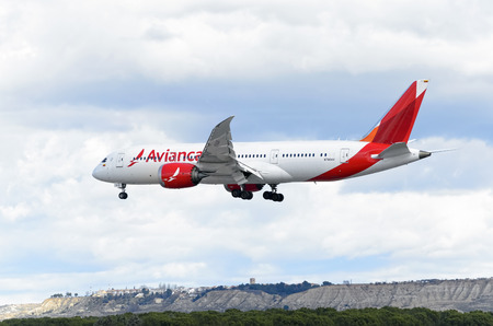 twin engine: MADRID, SPAIN - MARCH 05th 2016: Aircraft -Boeing 787-8 Dreamliner-, of -Avianca- airline, is coming, ready to land, to Madrid Barajas airport (Spain), on March 05th 2016. Photo set: 4 of 5.