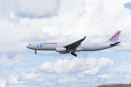 twin engine: MADRID, SPAIN - MARCH 05th 2016: Jet airliner -Airbus A330-300-, of -Air Europa- airline, is coming, ready to land, to Madrid Barajas airport (Spain), on March 05th 2016. Photo set: 1 of 3