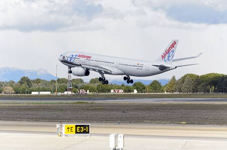 twin engine: MADRID, SPAIN - MARCH 05th 2016: Jet airliner -Airbus A330-300-, of -Air Europa- airline, is landing over runway, in Madrid Barajas airport (Spain), on March 05th 2016. Photo set: 2 of 3. Editorial