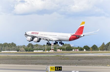 barajas: MADRID, SPAIN - MARCH 05th 2016: Aircraft -Airbus A340-642-, of -Iberia- airline, is landing in Madrid Barajas airport (Spain), on March 05th 2016. Photo set: 2 of 3.