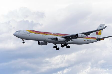 barajas: MADRID, SPAIN - MARCH 05th 2016: Jet airliner -Airbus A340-300-, of -Iberia- airline, is coming, ready to land, to Madrid Barajas airport (Spain), on March 05th 2016. Photo set: 1 of 3. Editorial