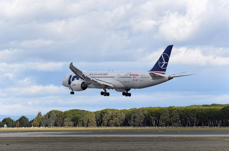 barajas: MADRID, SPAIN - MARCH 05th 2016: Passenger jet aircraft -Boeing 787-8 Dreamliner-, of LOT Polish Airlines, is landing over runway, in Madrid Barajas airport (Spain), on March 05th 2016. Photo set: 2 of 4.