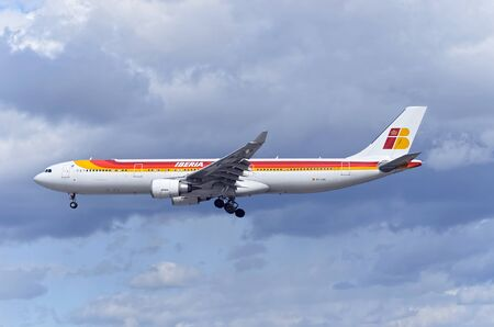 barajas: MADRID, SPAIN - MARCH 05th 2016: Passenger jet aircraft -Airbus A330-302-, of spanish airliner -Iberia-, is coming, ready to land, to Madrid Barajas airport (Spain), on March 05th 2016. Photo set: 1 of 2. Editorial